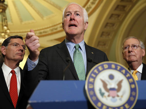Senate Majority Whip John Cornyn of Texas, center, flanked by Sen. John Barrasso, R-Wyo., left, and Senate Majority Leader Mitch McConnell of Ky., speak to the media Tuesday, on Capitol Hill.