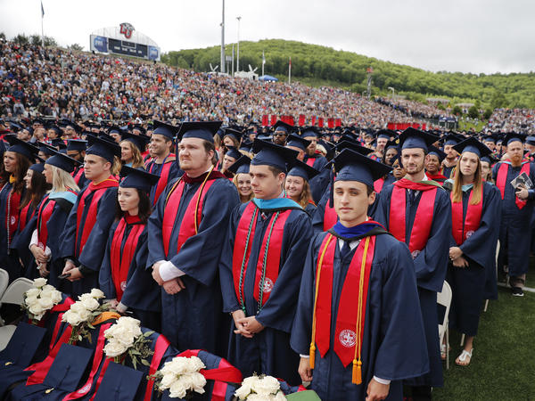 Members of the Class of 2017 stand as they wait for the arrival of President Donald Trump to give the commencement address at Liberty University in Lynchburg, Va., on Saturday.