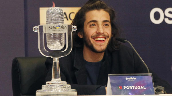 """Salvador Sobral of Portugal smiles as he speaks at a news conference on Saturday after winning the Eurovision Song Contest with his song """"Amar Pelos Dois"""" in Kiev, Ukraine."""