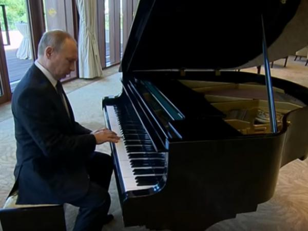 Russian President Vladimir Putin tried hammering out a couple of tunes Sunday in Beijing.