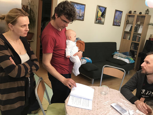 <em></em>Anna Sazonkina and Vladislav Komissarchuk (holding baby), oppose their north Moscow apartment building being torn down. Their neighbor Roman Gorsky (right) says he plans to vote for its demolition.