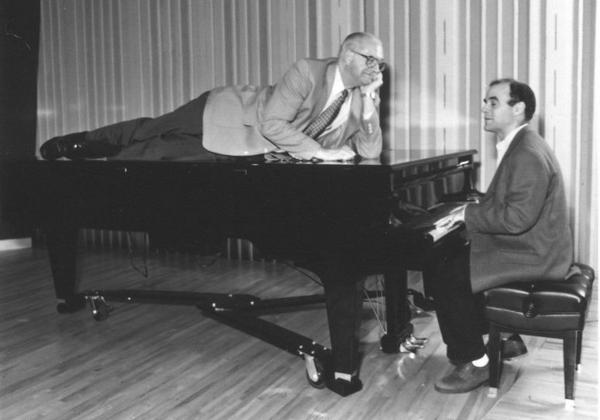 Kasell decides to take a publicity photo shoot up a notch while <em>Wait Wait... Don't Tell Me! </em>host Peter Sagal tickles the ivories.