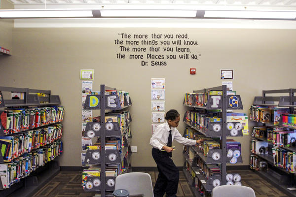 A student picks out a book for silent reading time at St. Marcus Lutheran School in Milwaukee.