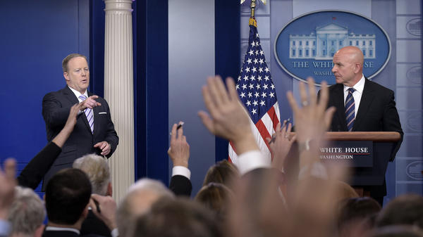 White House press secretary Sean Spicer (left) calls on a reporter during a press briefing appearance by national security adviser H.R. McMaster on Tuesday.