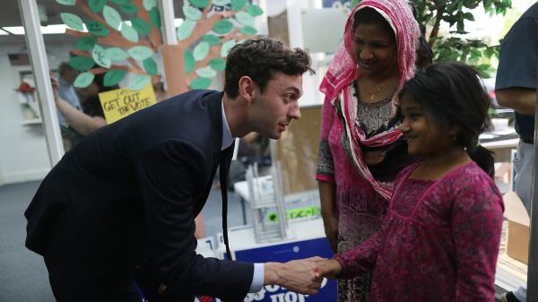 Democratic candidate Jon Ossoff greets Samira Ahsan and her mother Sharifa Jahan at a campaign office as he runs for Georgia's 6th Congressional District in a special election.