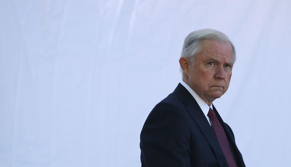 "Attorney General Jeff Sessions waits to be introduced during a service at the National Law Enforcement Officers Memorial on May 9 in Washington, D.C. Sessions issued an order on Monday narrowing the scope of his financial threat to ""sanctuary cities."""