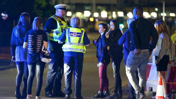 Police and fans outside the Manchester Arena on Monday, following reports of an explosion after Ariana Grande had performed.