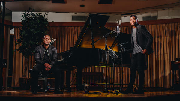 """John Legend (left) and Gallant perform Legend's song """"Overload"""" in a new video."""
