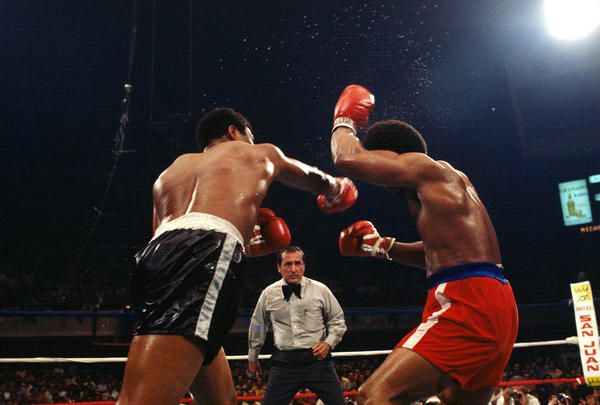 In 1977, Foreman (right) had a chance to regain his title in a fight against Jimmy Young (left). Young won the fight with a 12-round unanimous decision.