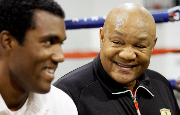"""George Foreman (right) smiles as he talks about his son, George Foreman III (left) in Houston in 2009. """"I was too focused on the one-two,"""" he says of his early days in the ring."""