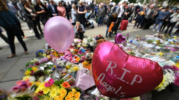 Balloons and flowers filled a memorial in Albert Square in central Manchester, in northwest England, in tribute to the victims of the Monday night attack at the Manchester Arena.