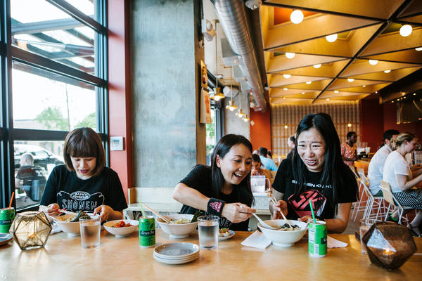 "(Left to right) Risa, Naoko and Atsuko of the band Shonen Knife eat ramen at Haikan in Washington, D.C., before playing a show. D.C. was one of their stops on a self-titled ""Ramen Adventure Tour"" of the U.S. By night, they play gigs. By day, they sample ramen in cities across the country."
