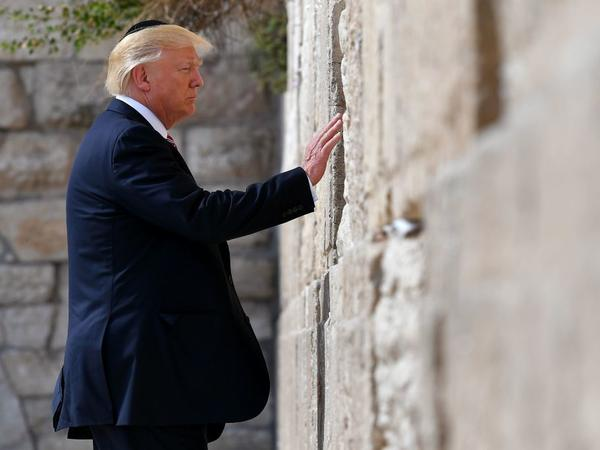 President Trump visits the Western Wall, the holiest site where Jews can pray in Jerusalem's Old City on Monday.