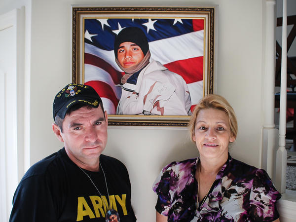 George Rincon and Yolanda Reyes stand with a portrait of their son Diego Rincon. The family immigrated to the U.S. from Colombia in 1989. Diego served in the Army and was killed in Iraq in 2003.