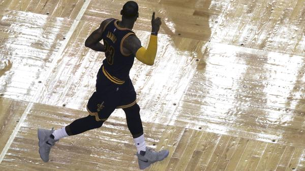 Cleveland Cavaliers forward LeBron James celebrates his three-point basket during the second half of Game 5 of the Eastern Conference finals against the Boston Celtics on Thursday in Boston. The points made James the NBA's all-time leading playoffs scorer.