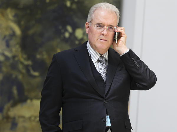 Robert Mercer speaks on the phone during the 12th International Conference on Climate Change on March 23, 2017.