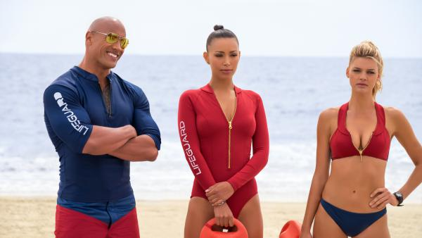 Dwayne Johnson, Ilfenesh Hadera and Kelly Rohrbach in the new guilty pleasure (until the story starts), <em>Baywatch.</em>