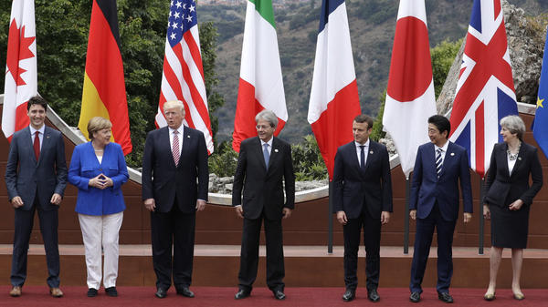 (From left) Canadian Prime Minister Justin Trudeau, German Chancellor Angela Merkel, U.S. President Trump, Italian Prime Minister Paolo Gentiloni, French President Emmanuel Macron, Japan's Prime Minister Shinzo Abe and British Prime Minister Theresa May pose during the G-7 summit in Taormina, Italy, on Friday.