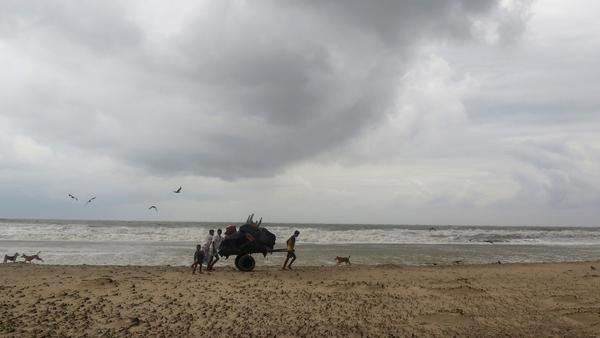 Bangladeshi villagers evacuate to cyclone shelters in Cox's Bazar district on Tuesday, as more than 350,000 people fled coastal villages to avoid Cyclone Mora.