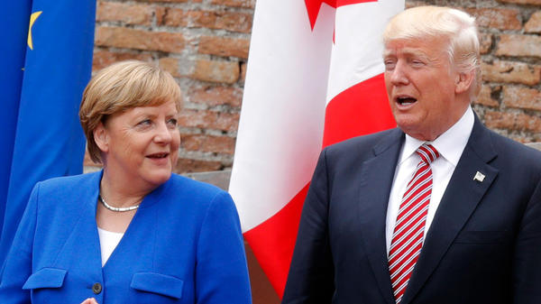 German Chancellor Angela Merkel and President Trump pose for a photo Friday at the ancient Greek Theater in Taormina, Sicily, during Trump's first G-7 summit.