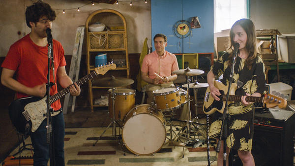 Married couple Ben (Adam Pally, left) and Anna (Zoe-Lister Jones) form a band with their weird neighbor Dave (Fred Armisen) in <em>Band Aid</em>.