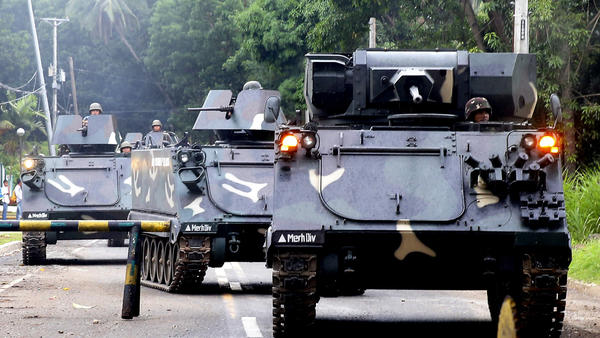 Tanks arrive at a military camp in Iligan, near the besieged Philippine city of Marawi, on Wednesday.