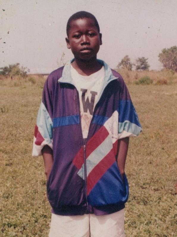 """In 2003, Mwinnyaa was a junior high school student. """"I didn't have a school uniform, and the shorts I was wearing had two big holes at the back,"""" he remembers. """"That is why I wore the oversize jacket, even though the weather was hot, to cover the holes."""""""