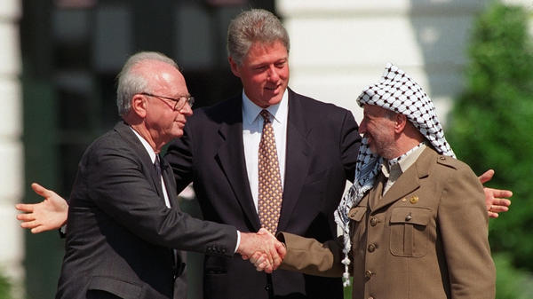 """President Clinton presides over  the 1993 interim peace accord between Israel and the Palestinians on the White House lawn with Israeli Prime Minister Yitzhak Rabin (left) and Palestinian leader Yasser Arafat (right). Years of negotiations followed, but the two sides couldn't reach a deal. Afterward, Clinton was highly critical of Arafat, telling him, """"I am a failure — and you made me one."""""""