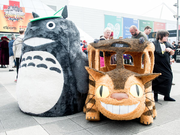 Totoro and the Catbus, the forest king's preferred mode of transportation, on display at a London comics convention in 2016.