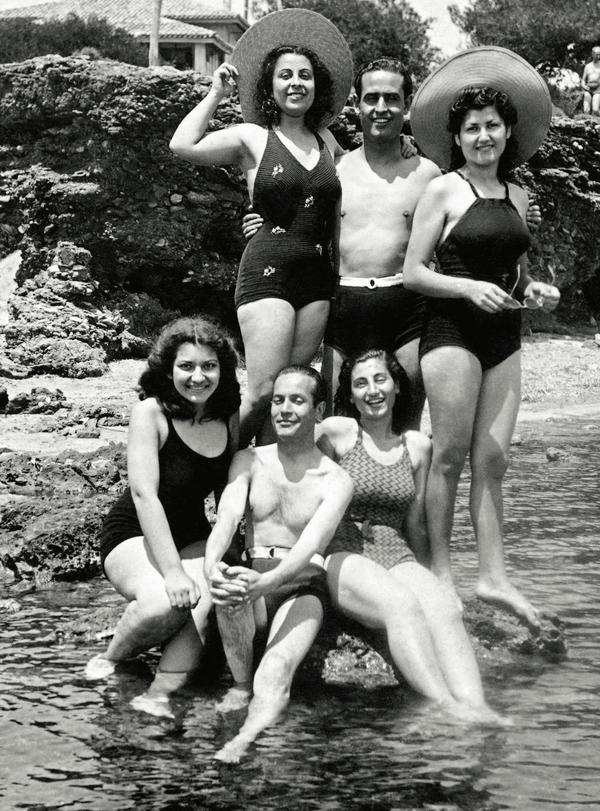 Maria Callas (lower left) poses with fellow students on a beach in Greece in 1939.