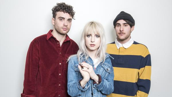 The members of Paramore (from left: Taylor York, Hayley Williams and Zac Farro) pair upbeat '80s sounds with bleak lyrics on <em>After Laughter</em>.