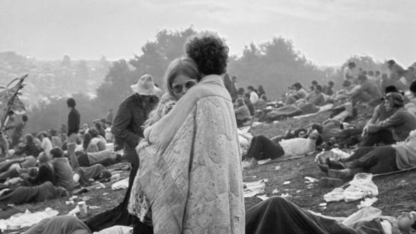 A couple embraces at the Woodstock music festival.