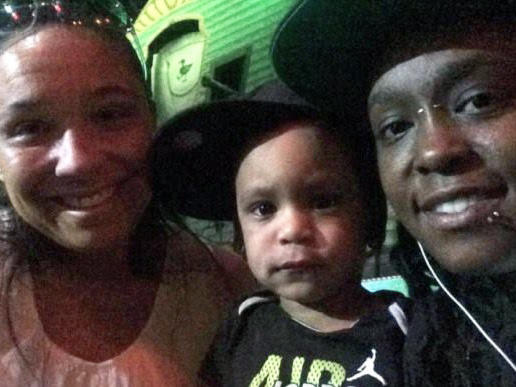 Emily Addison (left) and Deonka Drayton with their son.