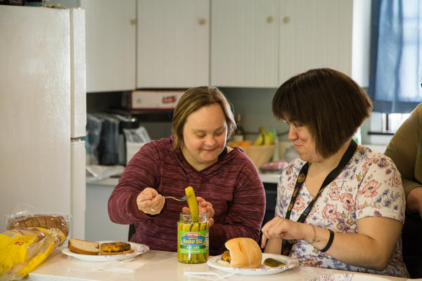 Danielle Wirsbinski (left) and Melissa Rodriguez prepare their lunch together during the cooking class.