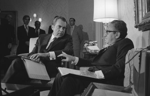 President Richard Nixon speaks with adviser Henry A. Kissinger in New York in November 1972.