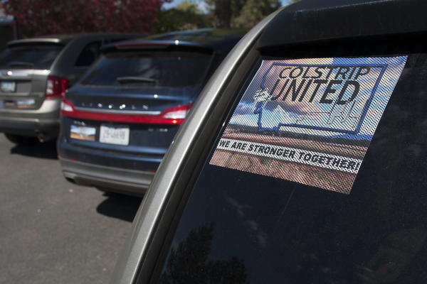 """Colstrip United"" banners, posters and car stickers can be seen all around Colstrip, Mont. The group aims to elevate pro-coal voices in the larger debate about energy."