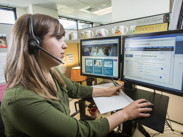 Jill Wiseman answers questions for the Contact Center based at the Fred Hutchinson Cancer Research Center in Seattle.