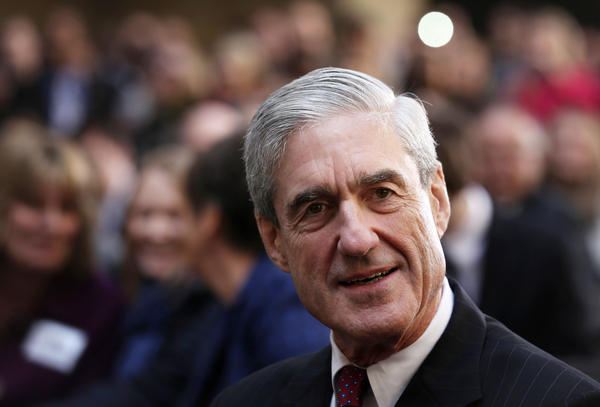 Former FBI Director Robert Mueller attends the ceremonial swearing-in of FBI Director James Comey at the FBI headquarters in 2013.