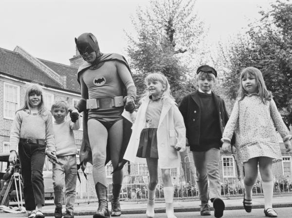 Adam West brings out his alter ego, Batman, for the filming of a 1967 road safety ad for children.