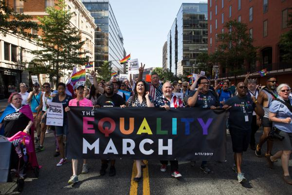Demonstrators at the front of the crowd lead thousands of others down 17th St. NW during the Equality March in Washington, D.C., on Sunday, June 11.