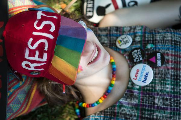 Sarah Corwin of Brooklyn, N.Y., relaxed in the shade on the National Mall during the Equality March in Washington D.C. on Sunday, June 11.