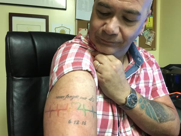 Terry DeCarlo, who runs an LGBT center in Orlando. He got a tattoo to honor those who died that day.