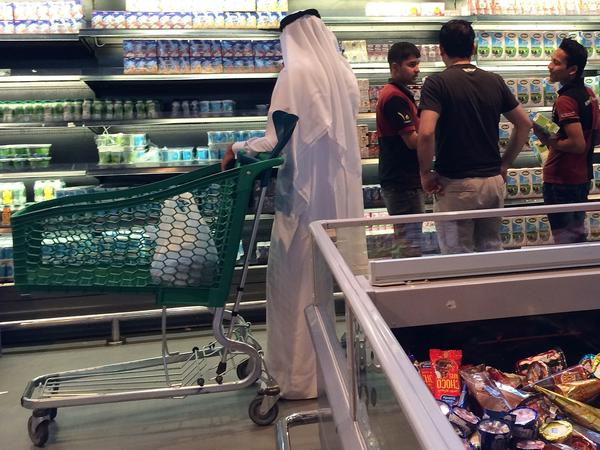 Customers shop at the Al Meera market in Doha, Qatar, on Saturday. Qatar faces possible food and dairy shortages after its Gulf Arab neighbors cut ties with the wealthy nation.