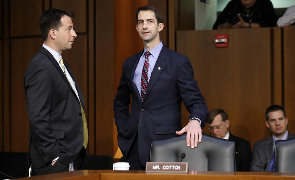 Sen. Tom Cotton, R-Ark. (right), talks with an aide before Attorney General Jeff Sessions is sworn in Tuesday.