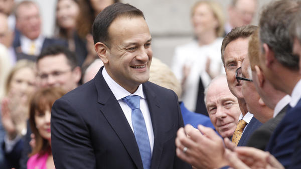 Ireland's newly elected prime minister, Leo Varadkar, shakes hands with members of a crowd gathered outside Leinster House, the seat of Irish Parliament in Dublin.