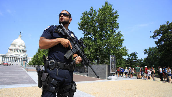 A Capitol Police officer stands guard on Capitol Hill in Washington, D.C., on Wednesday after House Majority Whip Steve Scalise, R-La., was shot during a congressional baseball practice in Alexandria, Va.