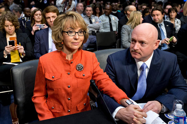 Former U.S. Rep. Gabrielle Giffords, who survived a gunshot to the head in 2011 during a mass shooting in Tucson, Ariz., sits with her husband two years later at a Senate Judiciary Committee hearing on Capitol Hill in Washington to discuss legislation to curb gun violence.