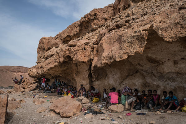 Somali and Ethiopian migrants crowd into caves in the coastal village of Mareero in the semi-autonomous region of Puntland. The migrants are waiting for smugglers with sailing boats to take them across the Gulf of Aden to Yemen.