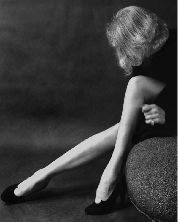 Dietrich wrote photographer Milton Greene notes on how to touch up her legs for this 1952 photograph.