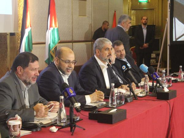 Hamas leader Khaled Mashaal (third from left) has been living in Qatar. The nation's ties to Hamas are among the Saudi and Gulf states' grievances.